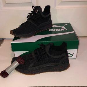 puma black high risk red sneakers